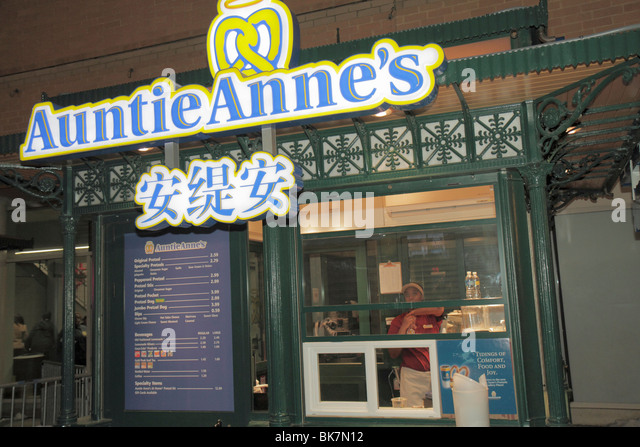 Washington DC Chinatown sign Auntie Anne's pretzel fast food snack business sign bilingual Chinese language - Stock Image