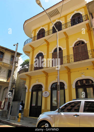 Bright yellow preserved and refurbished building featuring old classic architecture in Casco Viejo, Panama. - Stock Image