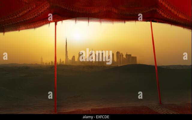 Futuristic cityscape from bedouin tent, Dubai, United Arab Emirates - Stock Image
