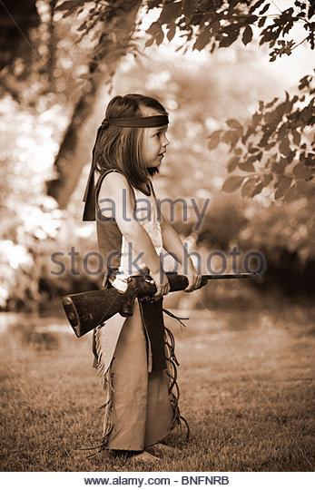Little boy playing alone with a real rifle - Stock Image