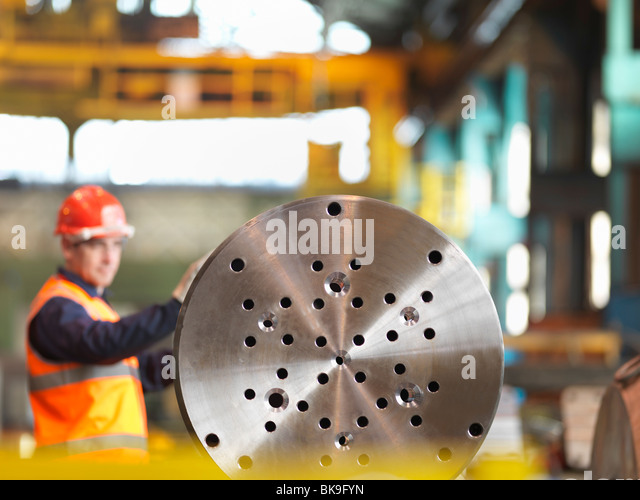 Engineer Working With Steel Part - Stock Image