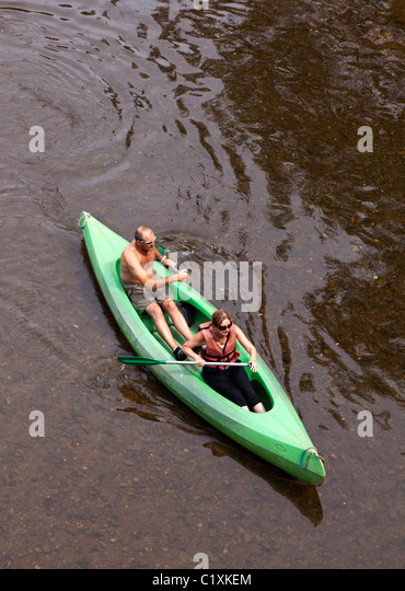 Two people in canoe on river Dordogne France - Stock Image