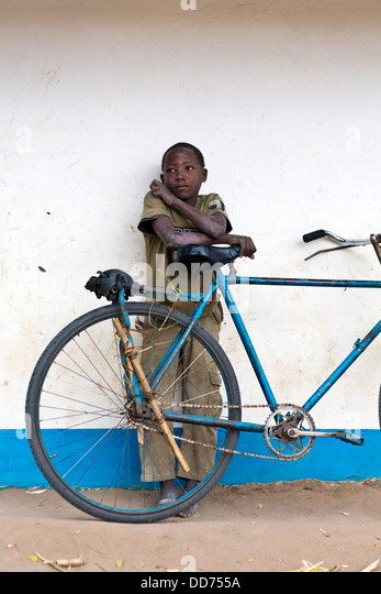 Mozambique, Nampula Province, boy and bicycle. - Stock Image
