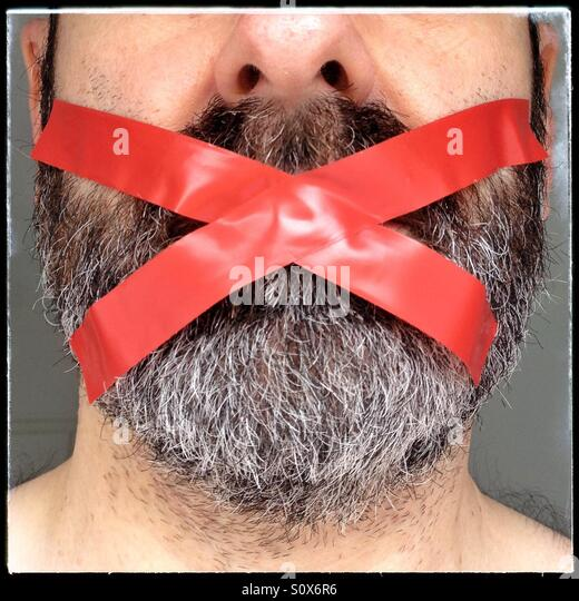 Gagged man - Stock Image