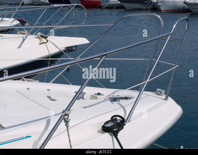 vessel boat white rowing boat sailing boat sailboat watercraft blue travel - Stock Image