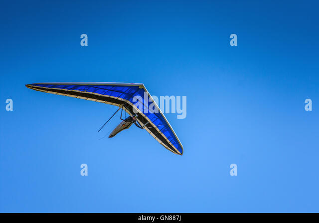 Hang glider above Stanage Edge, Peak District, blue - Stock Image