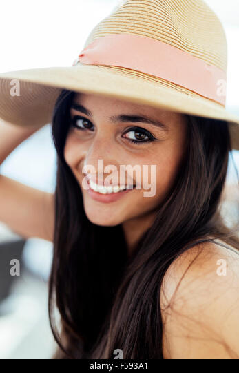 Woman in hat smiling and being truly happy - Stock Image