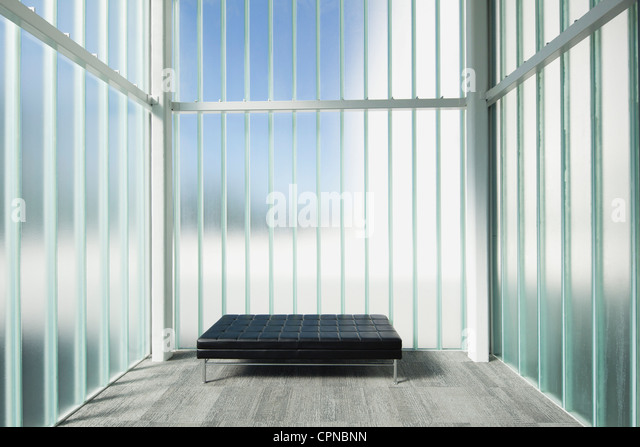Empty bench in modern lobby - Stock Image