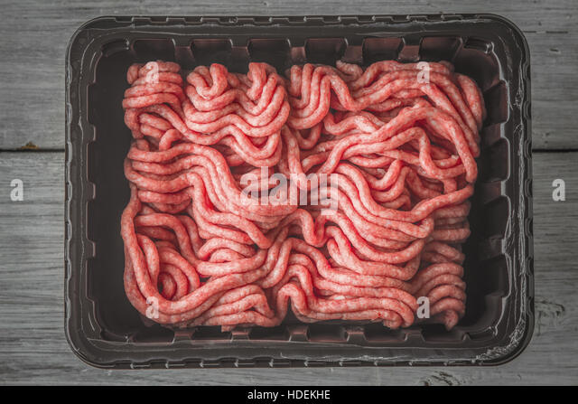 Raw mincemeat in the plastic box top view - Stock Image