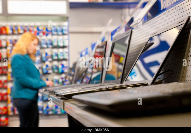 Testing the shops' assortment of laptops - Stock Image