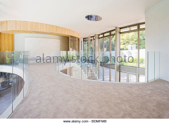 Upstairs walkway of modern home - Stock Image
