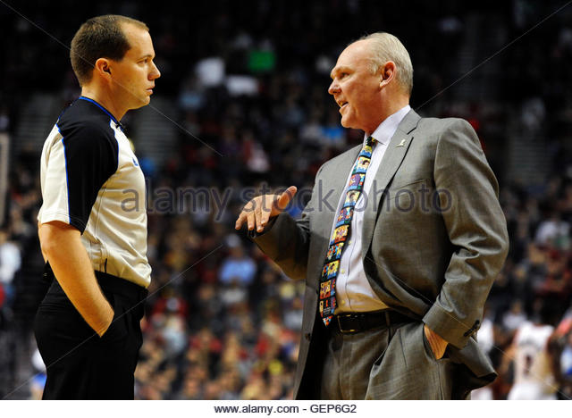 Denver Nuggets head coach George Karl (R) speaks with referee John Goble during the first quarter of their NBA basketball - Stock Image