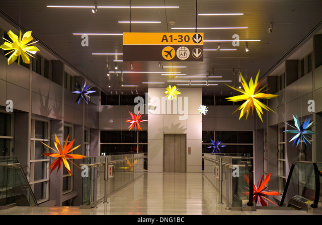 Texas Houston George Bush Intercontinental Airport IAH terminal concourse gate area inside interior decor decorations - Stock Image