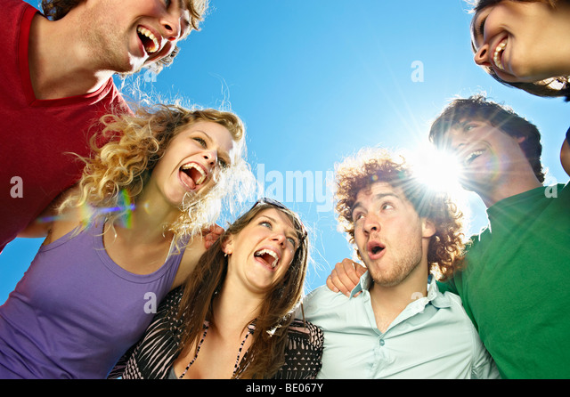 Portrait of six young happy people - Stock Image