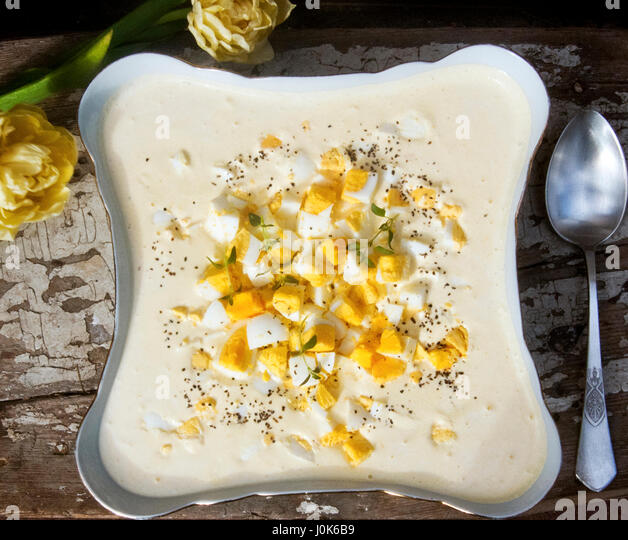 Hard boiled eggs in horseradish sauce. Traditional dish on Polish Easter table. - Stock Image