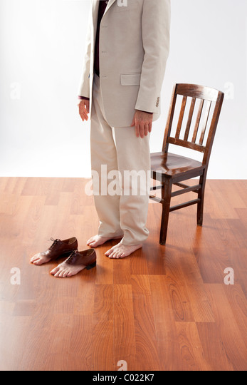 man about to put on shoes with real toes - Stock-Bilder