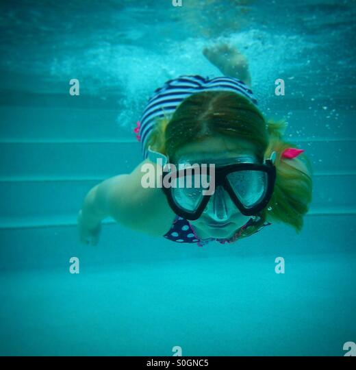 Swimming under the water - Stock Image