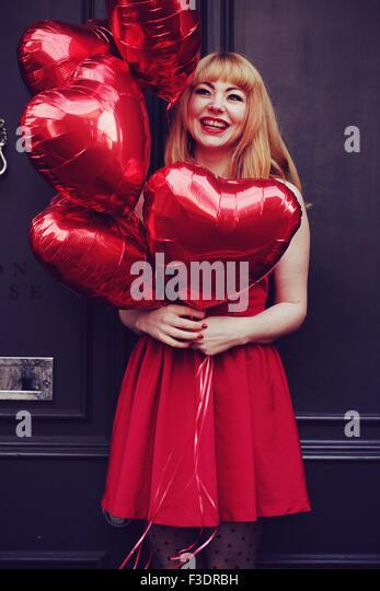 Young romantic themed woman in urban area - Stock-Bilder