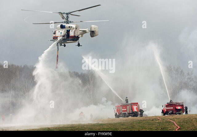 Moscow, Russia. 27th Apr, 2016. A Kamov Ka-32A battling fire during a fire training organized by the Russian Emergency - Stock Image