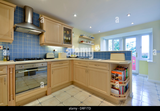 Fitted wood cupboards stock photos fitted wood cupboards for Wooden fitted kitchen