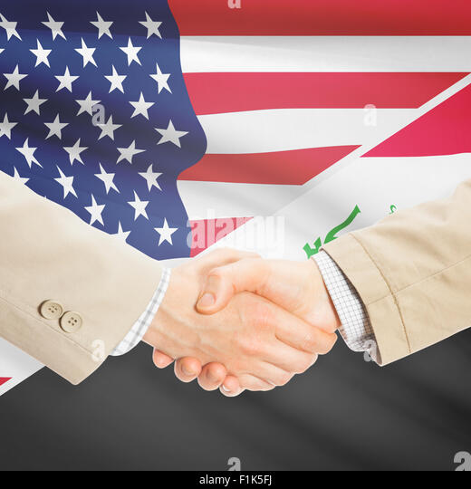 Businessmen shaking hands - United States and Iraq - Stock Image