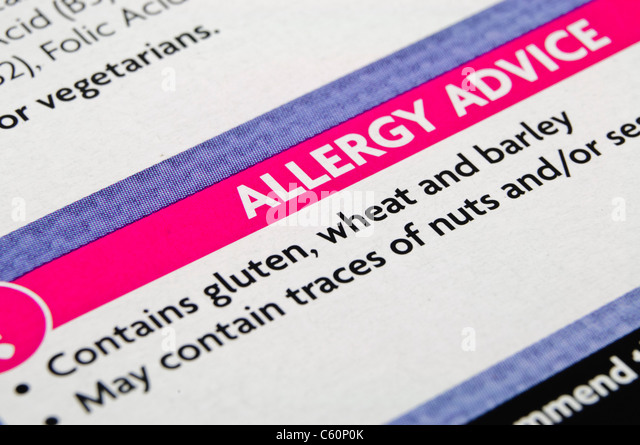 Food allergy label on a food packet indicating the presence of gluten, wheat and barley - Stock Image
