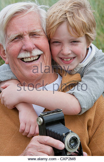 Portrait Of Grandfather And Grandson With Old Fashioned Camera In Sand Dunes - Stock-Bilder