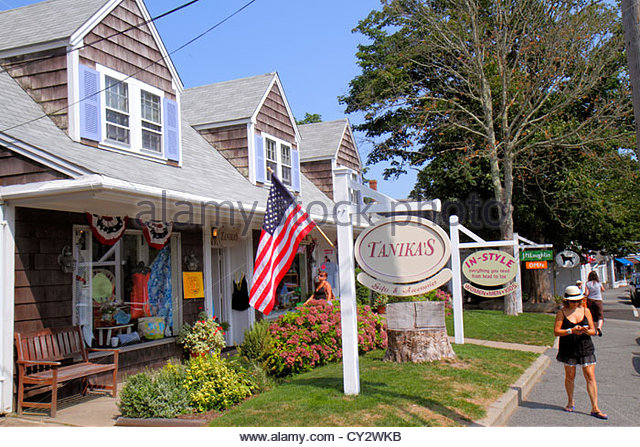 Massachusetts Cape Cod Chatham Main Street woman shops stores business shopping street scene signs - Stock Image