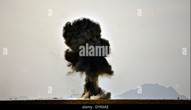 US Air Force explosive ordnance disposal technicians detonate four 500-pound bombs March 16, 2014 at Kandahar Airfield, - Stock Image