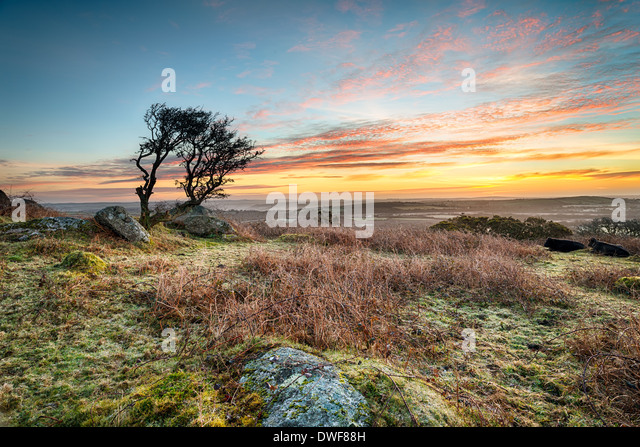 A frosty March sunrise at Helman Tor a craggy outcrop of rugged moorland near Bodmin in Cornwall - Stock Image