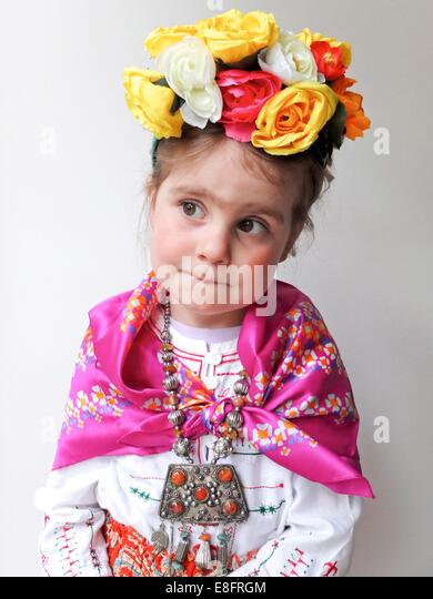 Girl (4-5) in Frida Kahlo costume - Stock Image