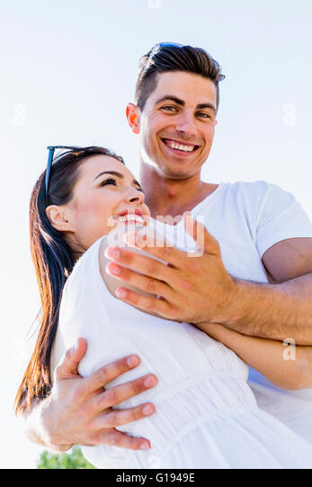 Beautiful couple hugging on a beautiful summer day - Stock-Bilder