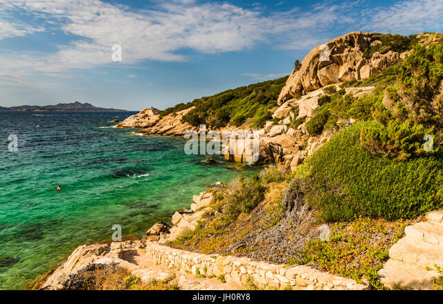Azure seaside scene at Baya Sardinia, Sardinia, Italy - Stock Image