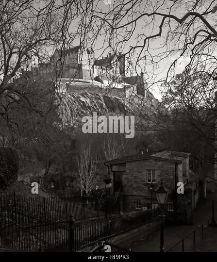 Edinburgh Castle in Winter, Scotland, UK from St Cuthberts graveyard in monochrome - Stock Image