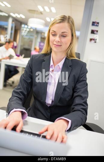 Female computer desk background keyboard - Stock Image