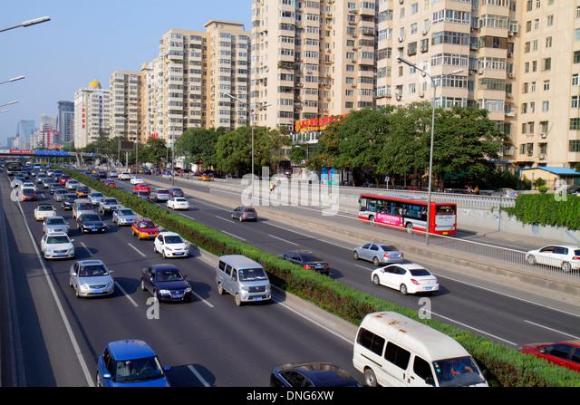 China Beijing Chaoyang District Panjiayuan traffic road street apartment buildings cars bus - Stock Image