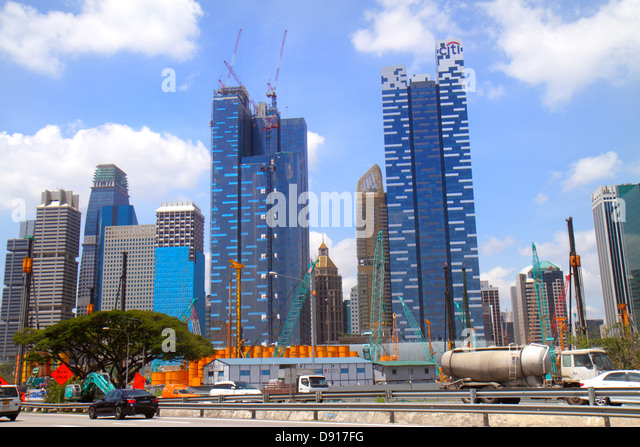 Singapore East Coast Parkway ECP city skyline financial district skyscrapers under construction buildings Asia Square - Stock Image