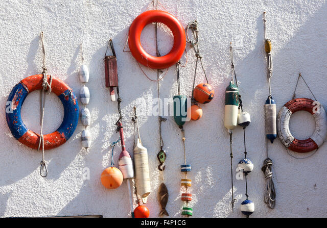 Boating odds and ends on a cottage wall at Lower Largo, East Neuk of Fife, Scotland UK - Stock Image