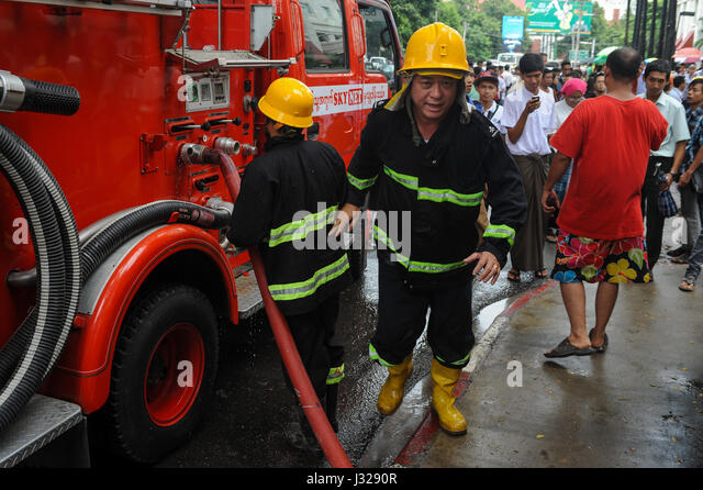 30.07.2013, Yangon, Republic of the Union of Myanmar, Asia - Two fire fighters during an emergency operation in - Stock Image