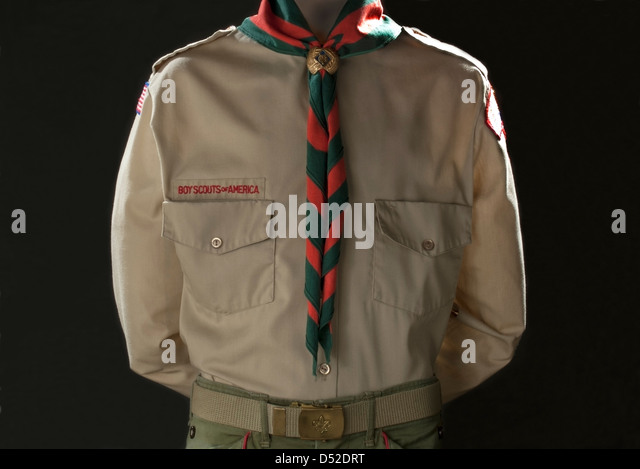 Classic Boy Scouts of America tan uniform with neckerchief and side. - Stock Image