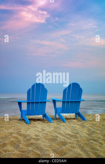 Two Adirondack chairs on beach. Hawaii, The Big Island - Stock Image
