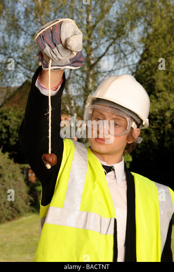 Schoolboy playing conkers - Stock Image