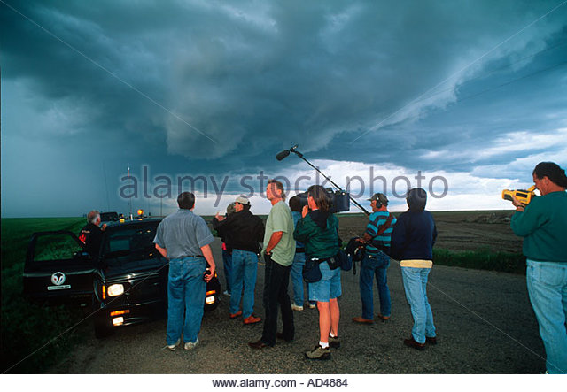 Storm Chasers Joel Ewing and Warren Faidley with film News crew from 48 Hours news program tracking tornado producing - Stock Image
