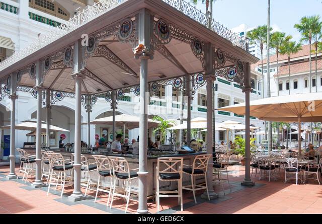 Raffles Courtyard at Raffles Hotel Singapore, Beach Road, Singapore Island, Singapore - Stock Image