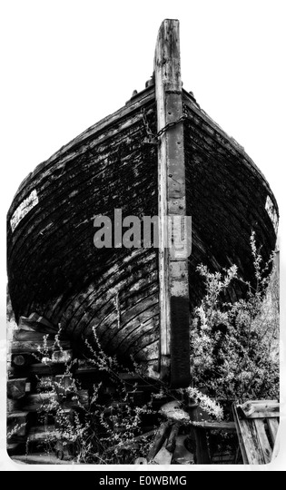 Old decayed wooden boat at the dockyard. - Stock Image