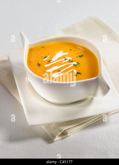 Carrot soup in bowl, close-up - Stock Image