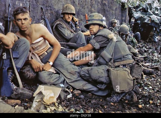 US Marine D. R. Howe treats the wounds of Private First Class D. A. Crum during the Tet Offensive June 2, 1968 in - Stock Image