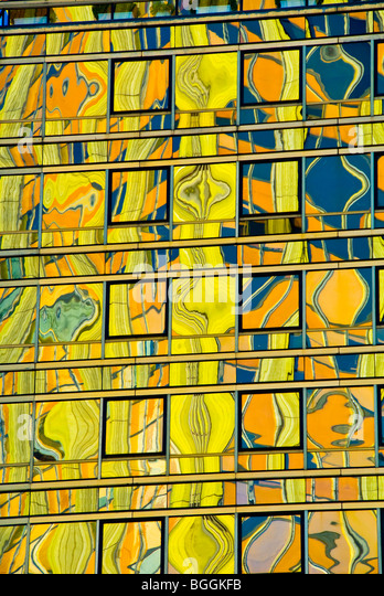 Colorful reflections in the glass surface of a high-rise building in Buenos Aires, Argentina - Stock Image