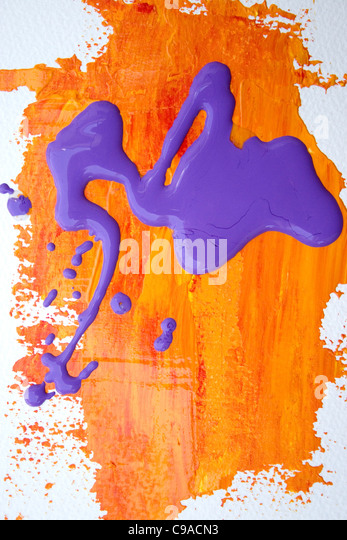Purple and Orange Paint Spill - Stock Image