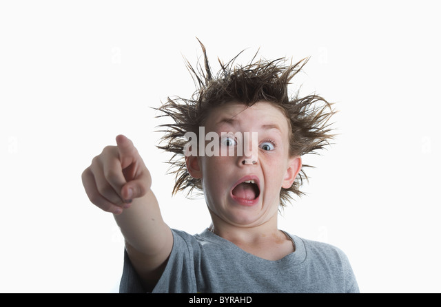 boy with crazy hair pointing his finger - Stock Image